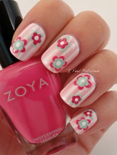 I began with Zoya Purity and then used striping tape. I polished Zoya GeiGei over the tape and pulled it off.  Next I used Zoya Lara, China Glaze Re-fresh Mint, and Purity to create modern flowers. I did this by dotting the outside petals with my largest dotting tool with one color and then using another color to dot just inside of the first set of dots. I finished off with one dot in the center!