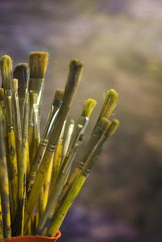 Yellow paint brushes