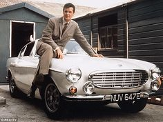 Suave: Roger Moore with an iconic Volvo as used in the 1960s TV Series The Saint.