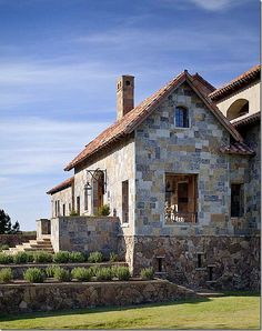 A Tuscan Dream in Mississippi - A view of the side of the front entrance.  This room is open to the elements – there is no glass in the windows, only wood shutters to keep out the rain.   Notice the charming window near the roof.   Notice also how the foundation stone is darker and randomly placed compared stone on the walls.