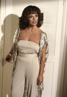 Joan Collins, spangles delightfully in gold.