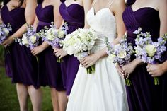 Purple bridesmaids dresses with white/purple flowers... Green as well is what I want