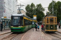 Helsinki, Finland: The newest and the oldest tram in the city met at the Market Square. The tram on the left was built this year while the vintage tram on the right is from Finland Culture, Light Rail, Train Layouts, Best Cities, Helsinki, Time Travel, Travel Inspiration, Old Things, Finland