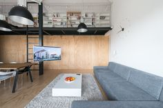 The interior of the three room loft has been designed to underline the main advantages of lofts – ease, casualness and space. Visible elements of the steel s...