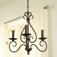 Petite chandeliers are a great way to dress up a room without engulfing it.  They look great in breakfast nooks, bathrooms, and closets!