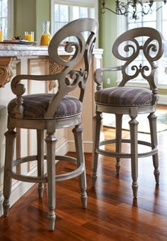 Influenced by Biedermeier design, the Louisa Barstool is simple and elegant. True to its inspiration, this handcrafted stool boasts generous proportions, a decorative back and an upholstered seat that make it comfortable and inviting.