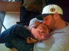 Tom Hardy Cuddles With A Dog