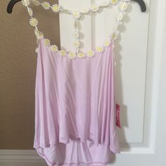 Pink strappy tank top! Super cute tank, never worn before! Size small but it just hangs a little too low for my taste. Price is negotiable, so make an offer Tops Tank Tops