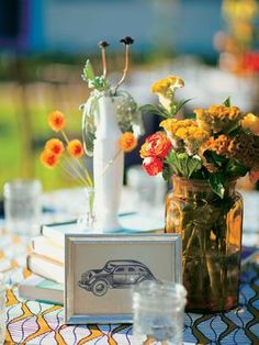 Love the Table (numbers)  Old-fashioned cars!    Photo: Our Labor of Love / The Knot