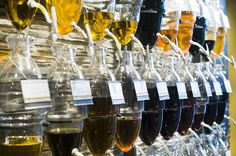 Experiencing Oil & Vinegar - amphora wall with over 25 different oils and vinegars