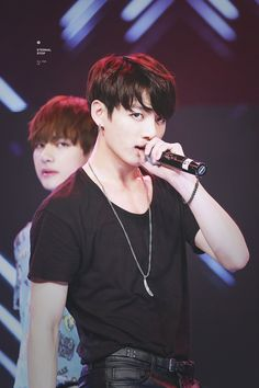 I normally wouldn't date a younger guy, but I'd make an exception for Kookie. He looks too manly for his age.