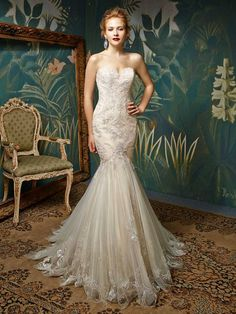 """*NEW ARRIVAL* """"Jion"""" from the 2017 Enzoani Blue collection, is one of our gorgeous new gowns. This delicate full-length embroidered lace and tulle gown is simply breathtaking. The form-fitting bodice is structured to show off every gorgeous curve, while the skirt softly flares out to add some romance. Jion radiates timeless elegance. Our sample is a size 12 and is in Ivory/Ivory it is also available in Ivory/Coffee/Silver and White/White"""