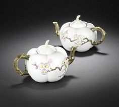Pair of Famille Rose Melon Teapots: 18th century rare pair of Famille Rose Melon Teapots and covers with Iron-red Qianlong seal marks.