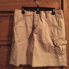 Gap distressed cargo skirt (never worn) Cute khaki cargo skirt. Perfect for casual summer! GAP Skirts Mini