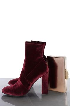 Nothing says Christmas like red and gold so why not up the festive factor by investing in rich velvet materials and glossy finishes. These Steve Madden ankle boots will lend an opulent edge to a jewel tone cocktail frock.