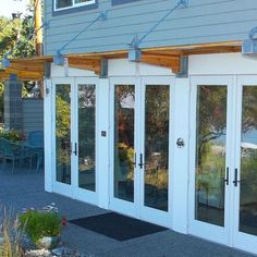 Modern suspended Awning.  - Dan Nelson A.I.A. Designs Northwest Architects