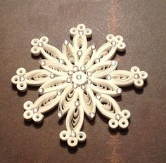 Paper Filigree Snowflake Quilled Snowflake Ornament White Christmas. $9.25, via Etsy.