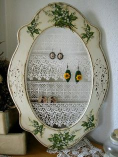 DIY Jewelry Frame ~ Paint and decoupage a vintage frame. Stretch lace and ribbons across the back and secure then hang up your earrings!