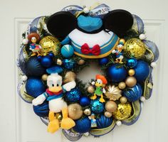 This is a fun Donald Duck Wreath for all the Disney fans who love this little guy! This was a special order for a Christmas present. I will