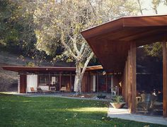 Modern home renovation in Napa includes redwood and glass facade with selamat design chairs
