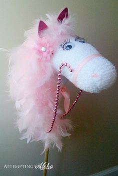 "DIY:: ""Possibly the Most Glamorous Hobby Horse Ever"" ~ I've got the pink feathered boa and Mardi Gras beads!! ;-)"