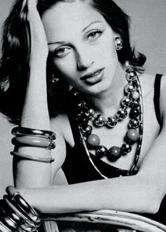 Ingmari Lamy is wearing necklaces and bracelets by Yves Saint Laurent, 1973                                                                                                                                                                                 More