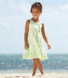 I love this pale green color. green wavy ruffles dress - Chasing Fireflies