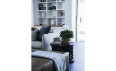 Colours - grey tile, white cabinets, wood accents and muted colours
