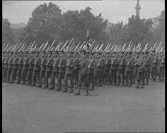 British soldiers march during a medal presentation ceremony. Watch the ceremony from the First World War here: http://www.britishpathe.com/video/presentation-of-medals
