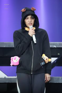 looking badass with the hoodie and then you notice the pushies in his pockets.the duality of kim jongin XD