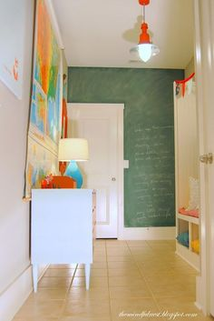 Mud Room Makeover What a bright adorable mud room! I adore that lantern (she painted it!), the storage, the chalkboard…it is all so cheery and happy! Check out the whole Room Tour over at The Mindful Nest Chalk Wall, Chalkboard Paint, Chalk Board, Chalkboard Ideas, Chalk Paint, Kid Spaces, Living Spaces, Room Tour, My Living Room