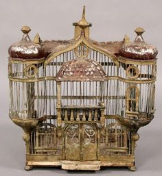 Antique French tole bird cage in the form of a chateau with shaped roof line and turreted sides, circa 1910