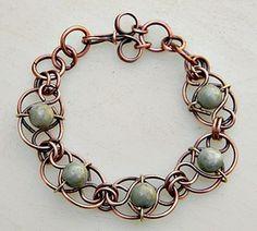 Jade Link Bracelet a gallery of work by Zoraida. Love this artists wire work!