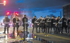 Apr 28, 2015 MATT ROURKE/ASSOCIATED PRESS Baltimore police officers standing guard Monday night. At least 15 officers were injured and dozens of people were arrested.
