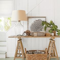 White walls and seafoam green floors—a cozy summer cottage full of beachy vignettes—make you want to kick off your shoes and stay awhile. | Coastalliving.com