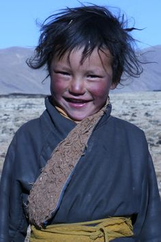 Nomadic herder boy 'purple cheeks' from the area where we source our yak wool ©kora