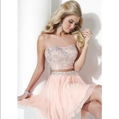 Beautiful 2 piece homecoming dress. Pearl pink I bought this for a formal event but never got to wear it!:( No flaws! Beautifully designed, and is comfortable to wear. If you have any questions feel free to ask!(: offers are welcome. Dresses
