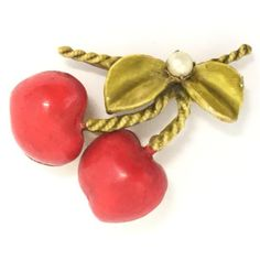 This gorgeous 1960's Robert Original Inc. (formerly known as The Fashioncraft Jewelry Co.) Cherry Red cherry fruit pin with faux pearl will look smart on your lapel, hat or scarf. The coloration of the enamel is quintessential Robert Originals, Inc. The vibrant and beautiful enamel, greenish and red, has been applied on a gold-toned metal. The pin is secured with a secure roll-over pin back. Product Specifications Type: broochStyle: cherry fruitDesign: Original by Robert Metal: alloy…