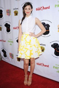 Emmy Rossum's spring-inspired look for the Saving Tails Gala in Los Angeles comprised a printed yellow skirt, button-up blouse and strappy sandals, paired with red lipstick and a side-slung plait.