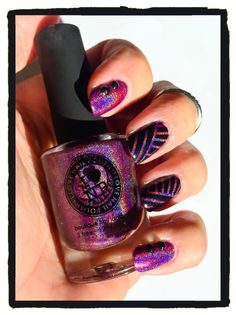 """I can see your halo. I Love Nail Polish """"Kings & Queens"""" holographic dazzles with Zoya """"Raven."""" Nail studs, nail tape."""