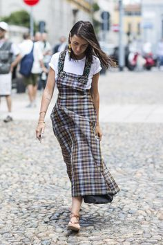 Modern grunge in a plaid maxi with a white tee underneath.