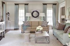 Tobi fairley interior design family room transitional with wall decor david hicks floral arrangement