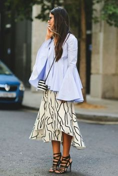 Bell sleeved pale blue top paired with black and white printed skirt