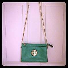Sea Foam Green Crossbody / Handbag Sea foam/mint green bag.  Can be worn as crossbody bag or handbag.  Gold hardware and chain strap. interior is 3 separate compartments with CC and ID slots.  A few small marks (see pic). 9x2.5x6 Bags Crossbody Bags
