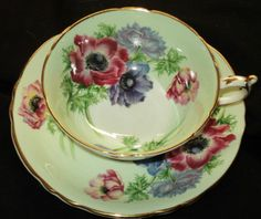 PARAGON POPPY ANEMONE GOLD GREEN WIDE TEA CUP AND SAUCER