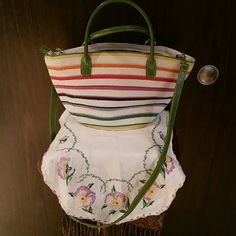 Summer straw purse You would be able to pair this purse with any spring /summer outfit. White with multiple colors surrounding the bag and has yummy green handles to wear on arm or use detachable crossbody/shoulder strap. Inside is same green with 2 open pockets and one zippered pocket. Bags Crossbody Bags