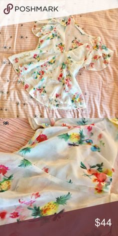 """Zara Watercolor Fruit Floral Print Flutter Blouse A flutter-sleeve Blouse from Zara in a super cute watercolor Floral fruit print with pineapples and kiwis and pomegranates. Approx 19"""" total length with a sweet v-neck neckline. 100% poly. Never worn. Big on me so I'm selling but I think it's true to size, I'm just small. Zara Tops Blouses"""