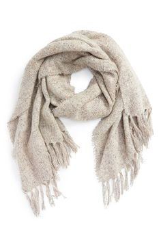 Knit with a soft, plush texture, this dreamy scarf looks great when piled on over the coziest fall layers.