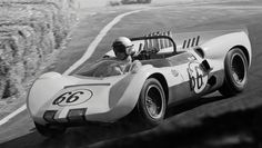 "Roger Penske races through the Laguna Seca ""corkscrew"" in his Chaparral 2 on his way to victory in the 1964 Monterey GP. This car had the shorter nose bodywork used in 1964. Photo restored and cropped. William Hewitt photo."