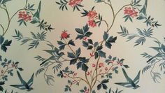 Bluebirds, flowers and leaves 1980's wallpaper illustration. White background with pink-red flowers, and blue leaves and branches. Taken at the The Stone-Gamble Mansion, decorated by Shirley Odneal Gamble from 1983 to 1985.